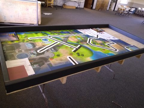 Lego League regulation tournament table with competition mat on it.